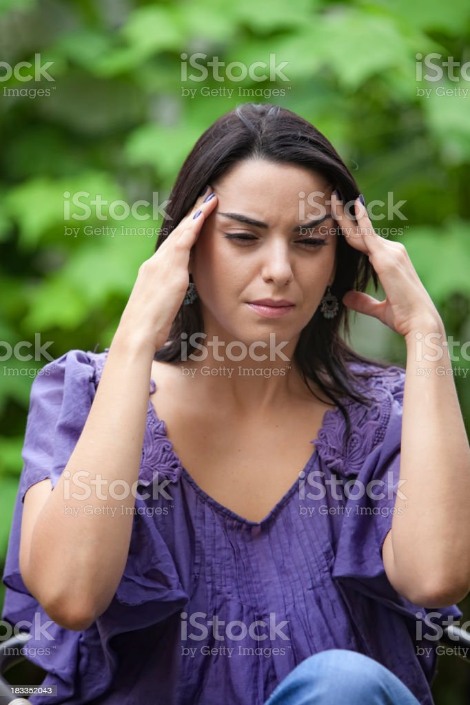 Young woman with a headache or migraine stock photo