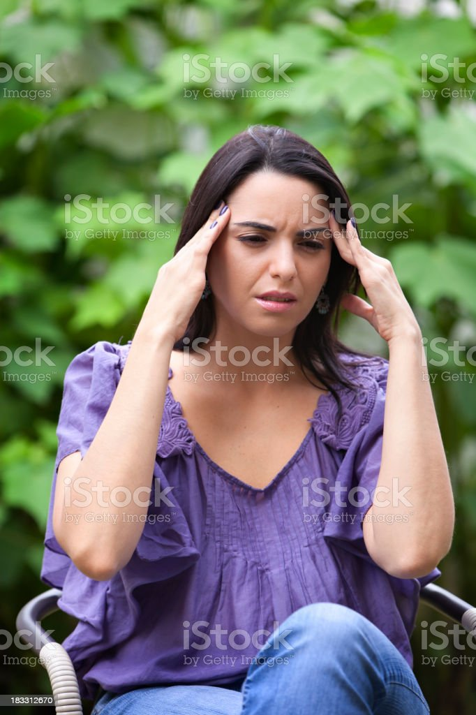 Young woman with a headache stock photo