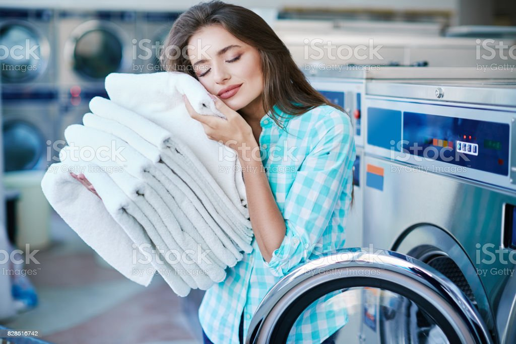 Young woman with a heap of linen stock photo