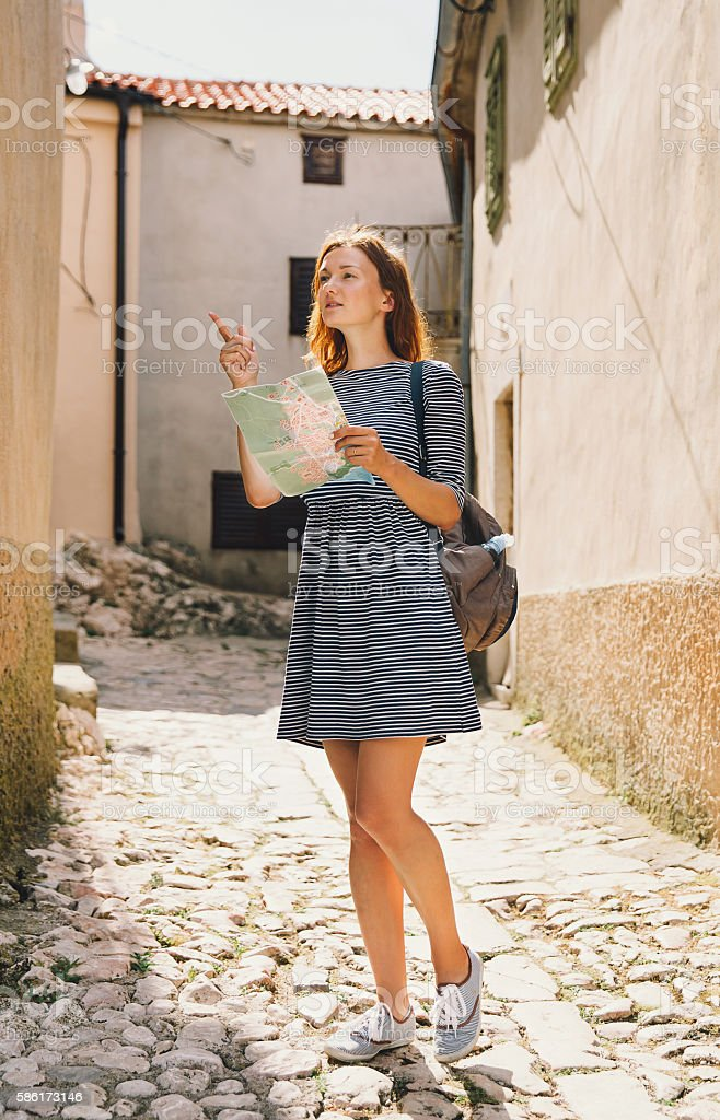 Young woman with a map on the  European streets stock photo