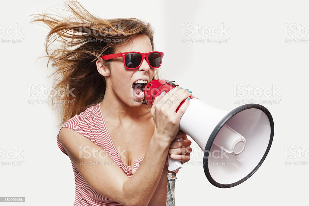 Young woman with a megaphone stock photo