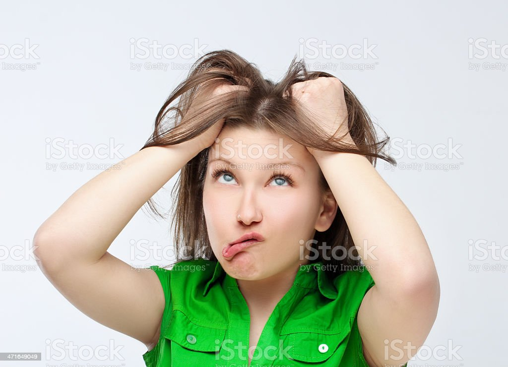 Young woman with a messy hair making  face. stock photo