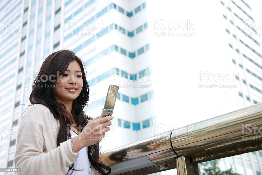 young woman with a mobile phone stock photo