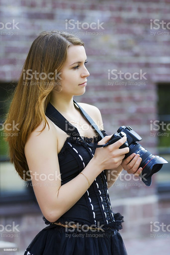 Young woman with a photo camera royalty-free stock photo
