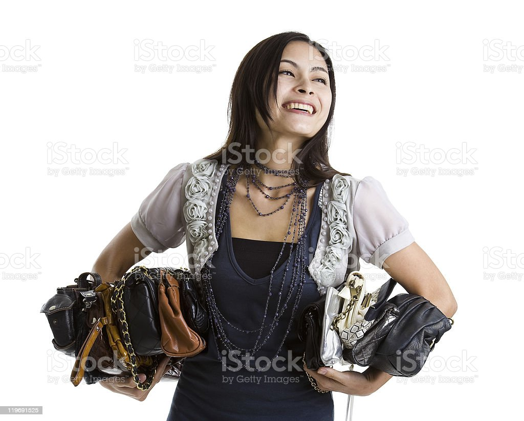 young woman with a purse collection, isolated on white background stock photo