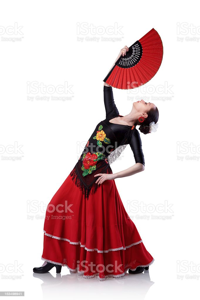 Young woman with a red fan dancing the flamenco in dress stock photo