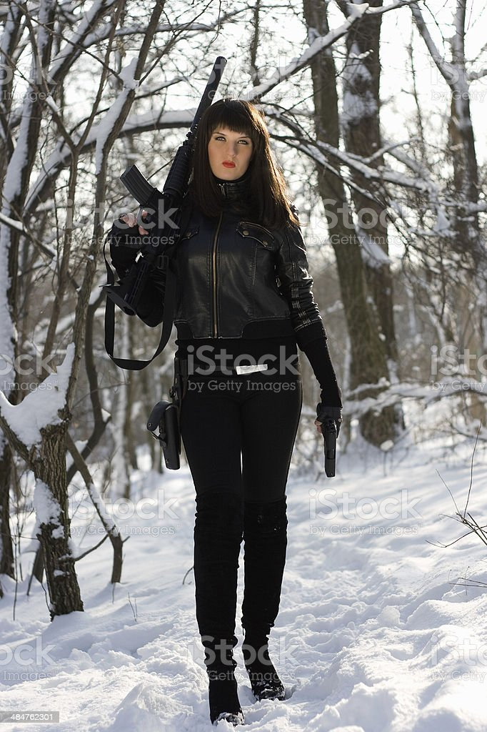 young woman with a rifle and pistol stock photo