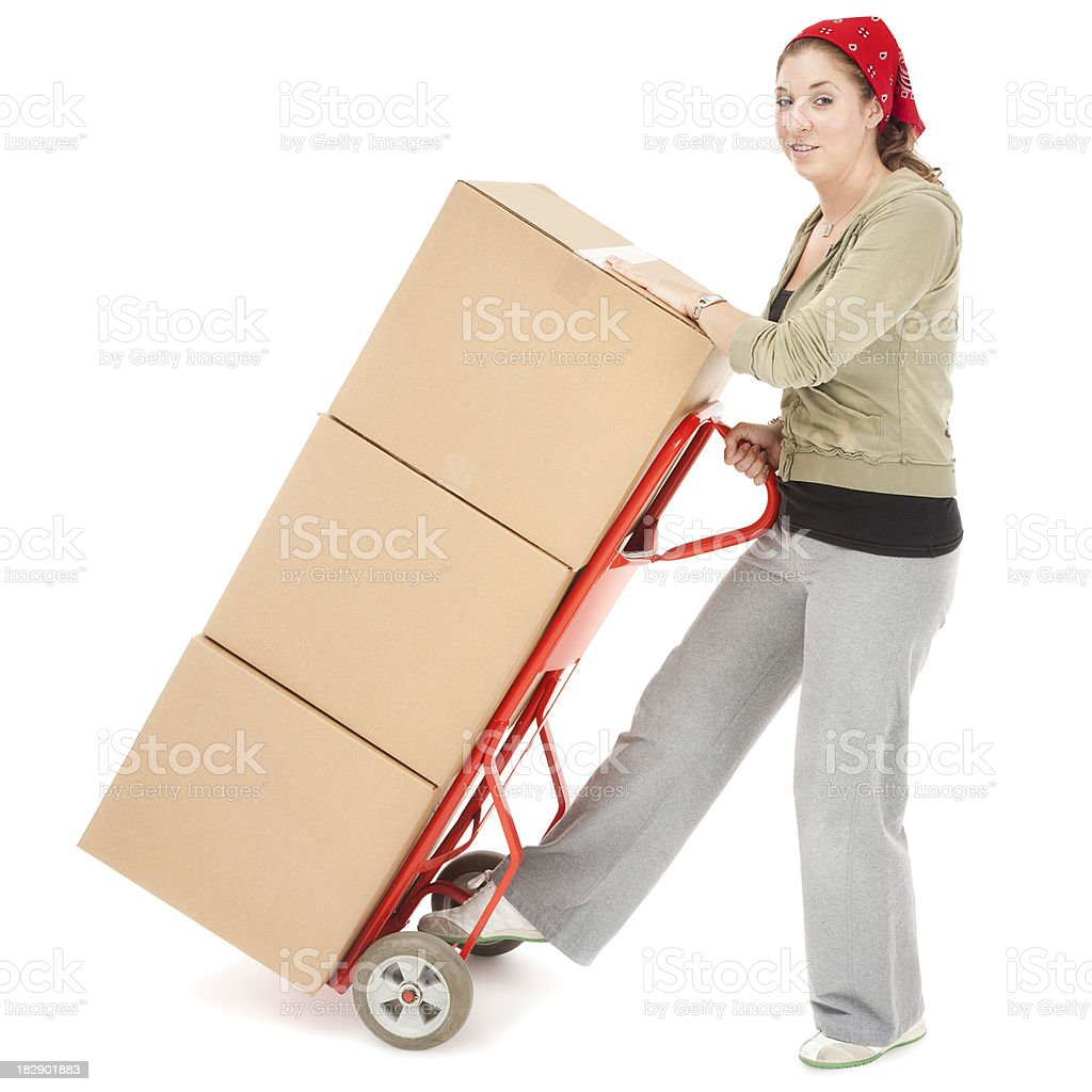 Young Woman with a Stack of Moving Boxes royalty-free stock photo
