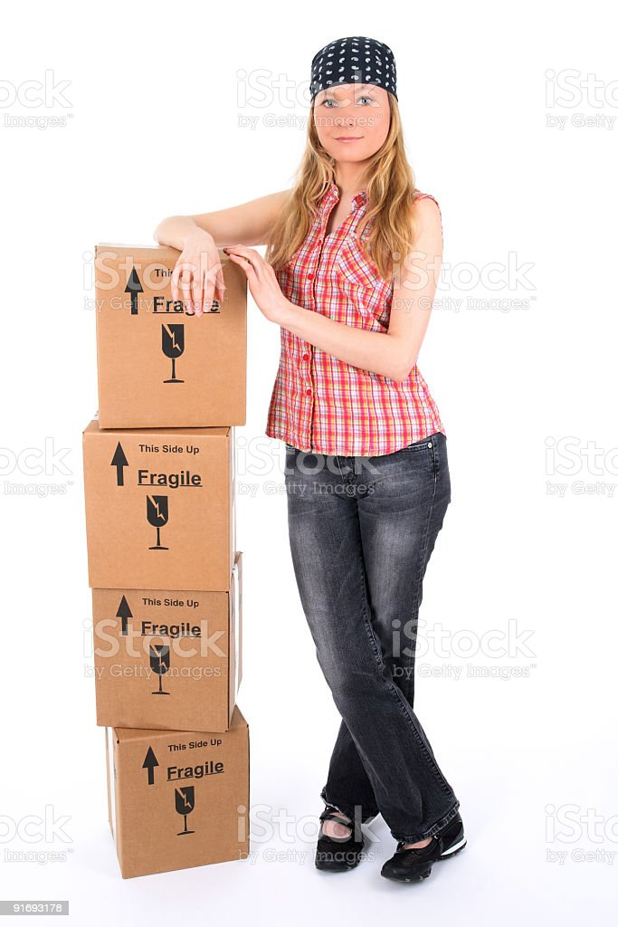 Young woman with a stack of parcels royalty-free stock photo