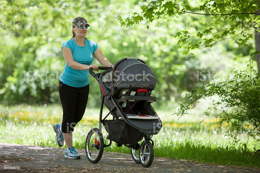 Young woman with a stroller stock photo