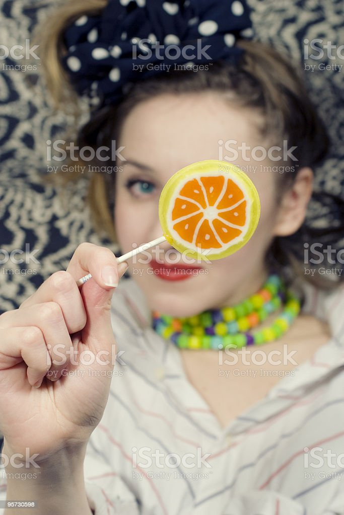young woman with a sugar candy stock photo