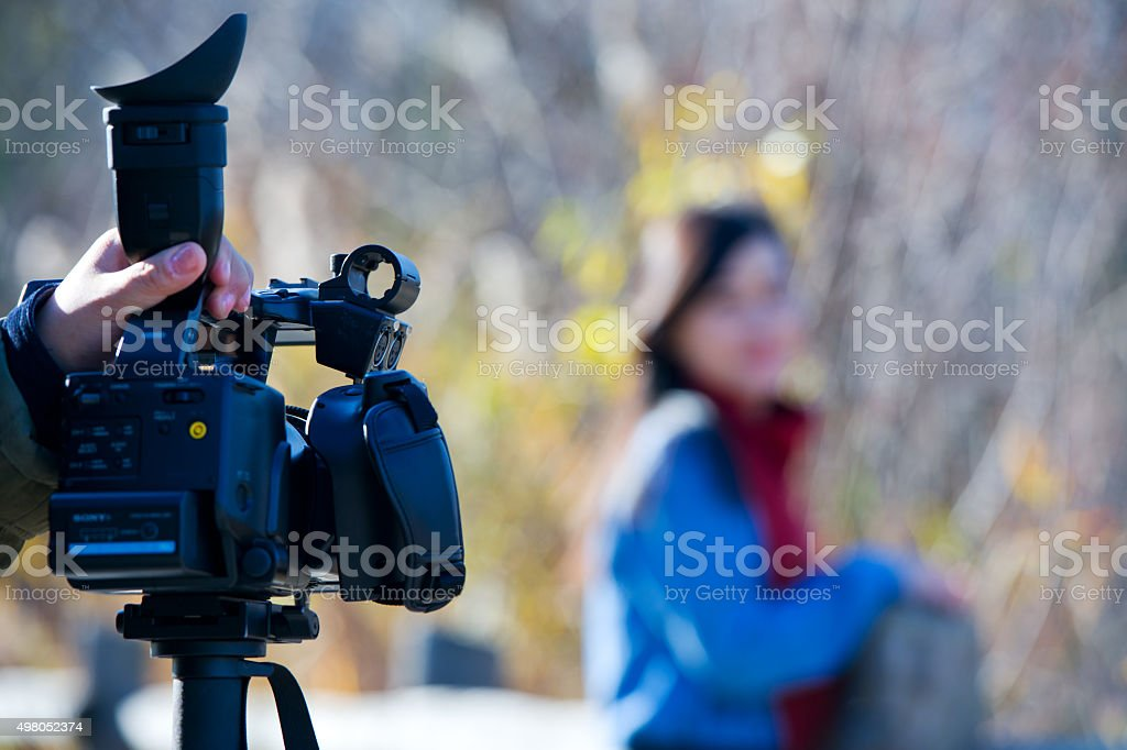 young woman with a video camera stock photo
