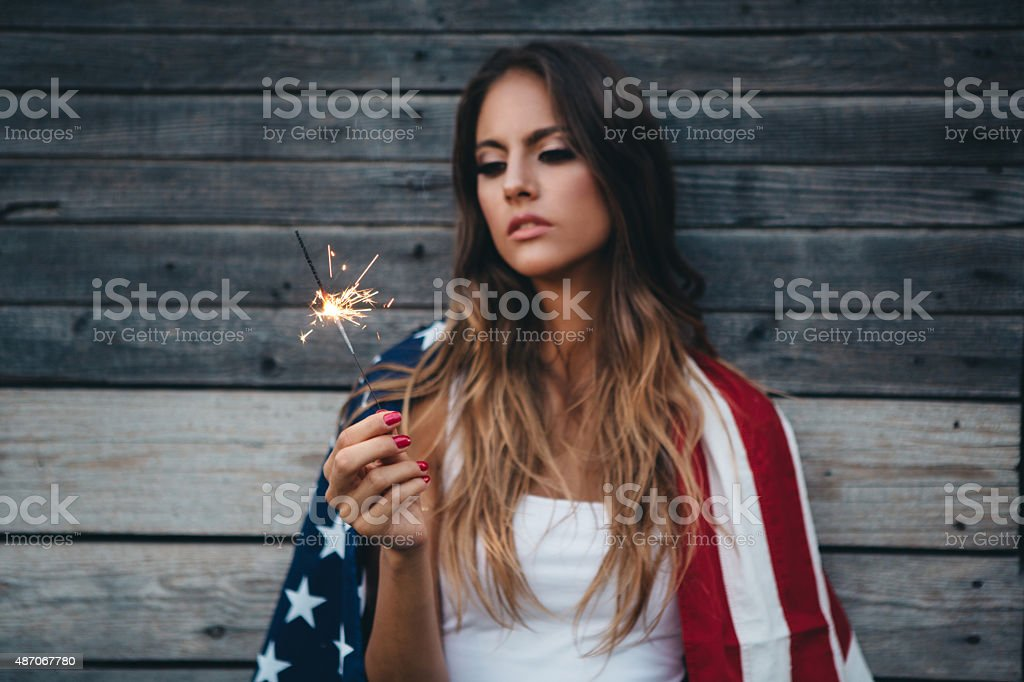 Young woman with American flag. stock photo