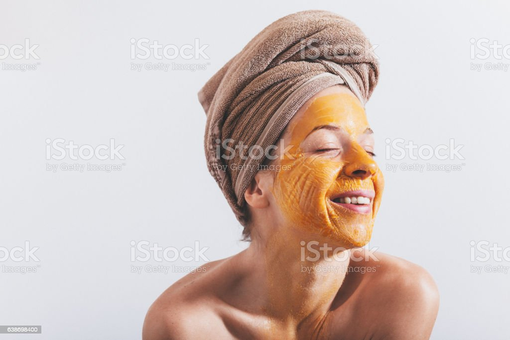 Young woman with an egg mask on her face stock photo