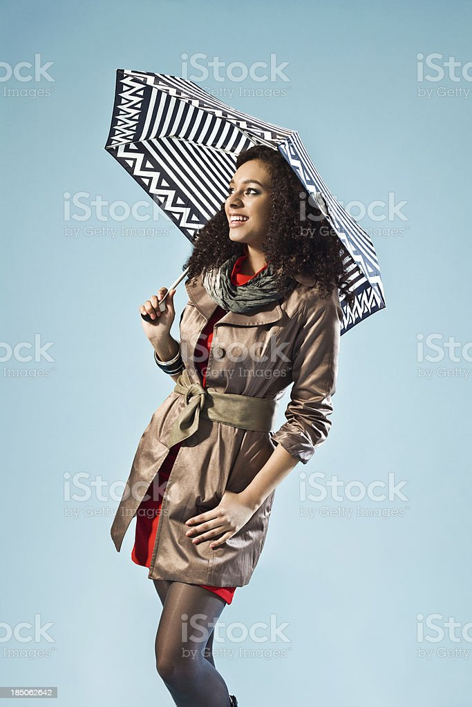 Young woman with an umbrella royalty-free stock photo