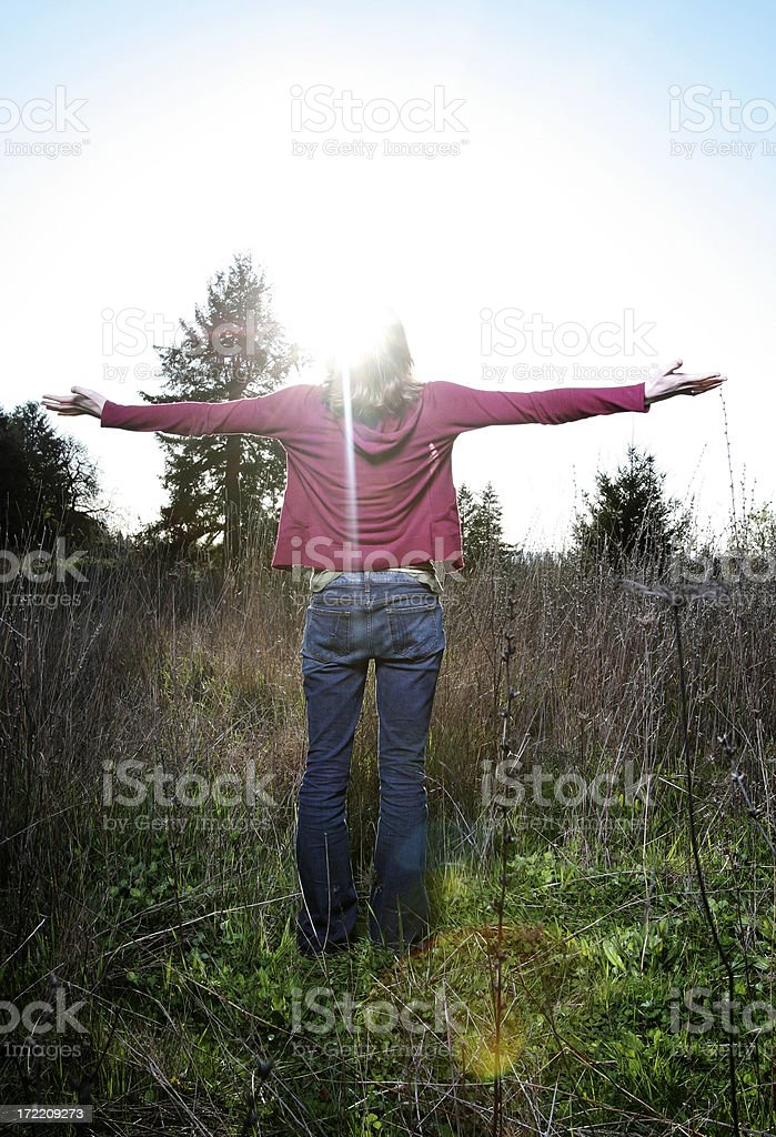 Young Woman With Arms Raised in Worship / Celebration royalty-free stock photo