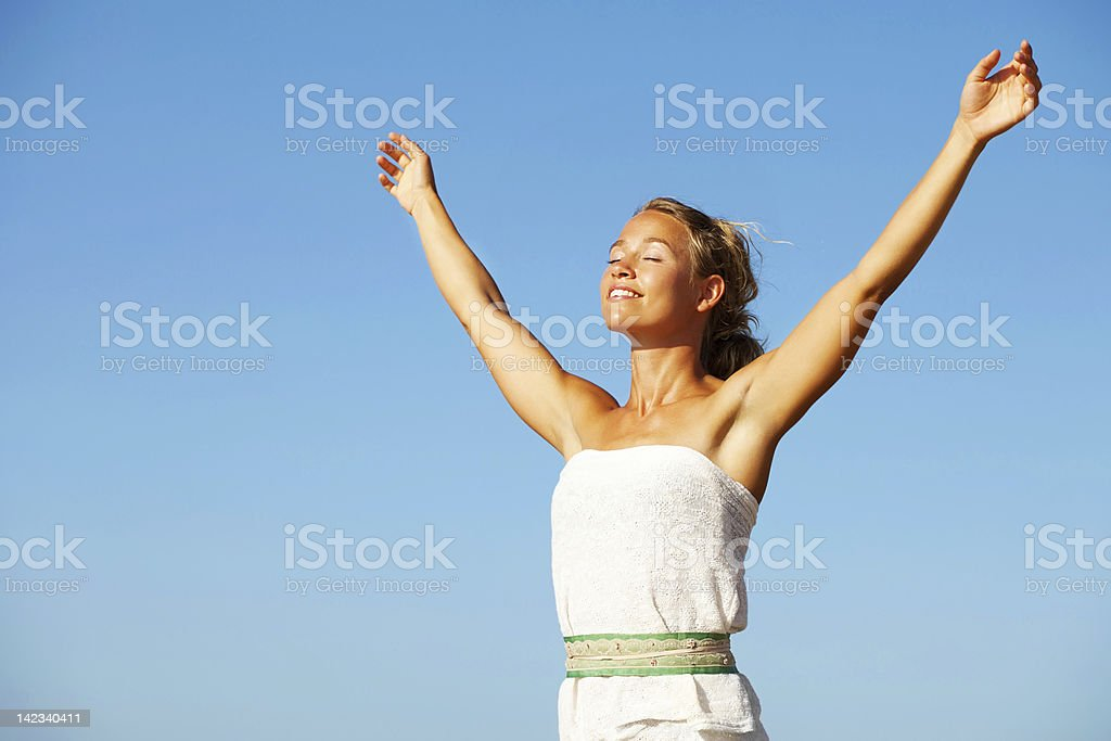 Young woman with arms raised stock photo