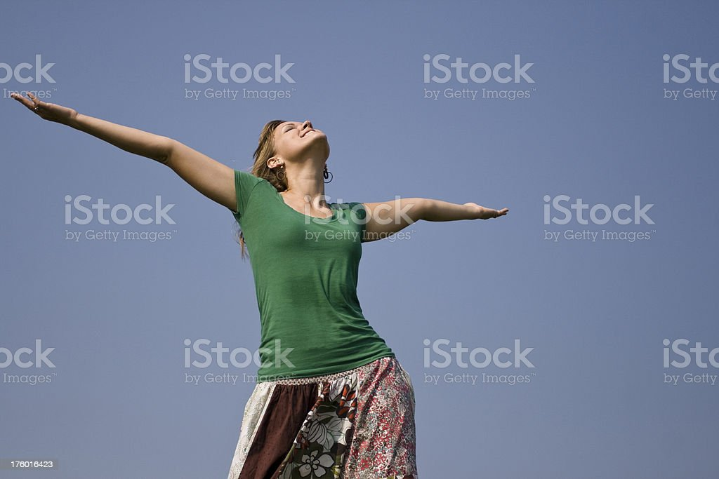 Young Woman With Arms Raised to The Sky. royalty-free stock photo