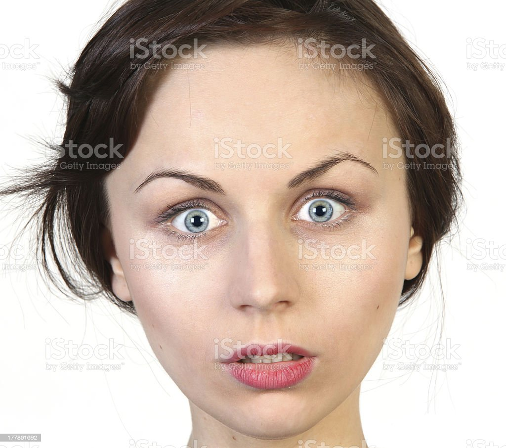 Young woman with astonished expression stock photo
