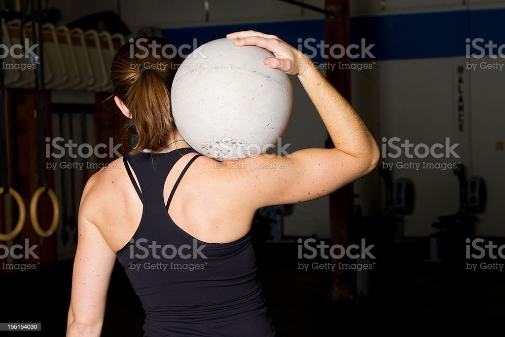 Young Woman with Atlas Ball royalty-free stock photo