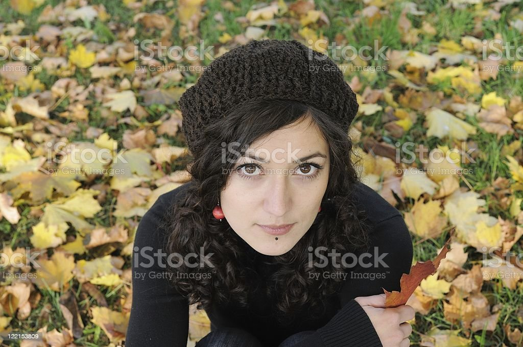 Young woman with autumn leaves royalty-free stock photo
