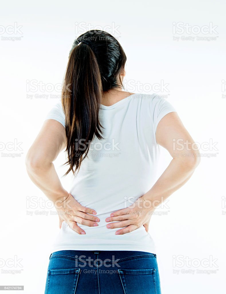 Young woman with backache stock photo
