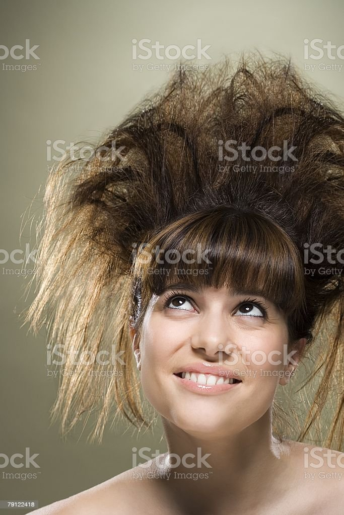 Young woman with backcombed hair stock photo