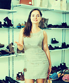 Young woman with bags  in shoes store