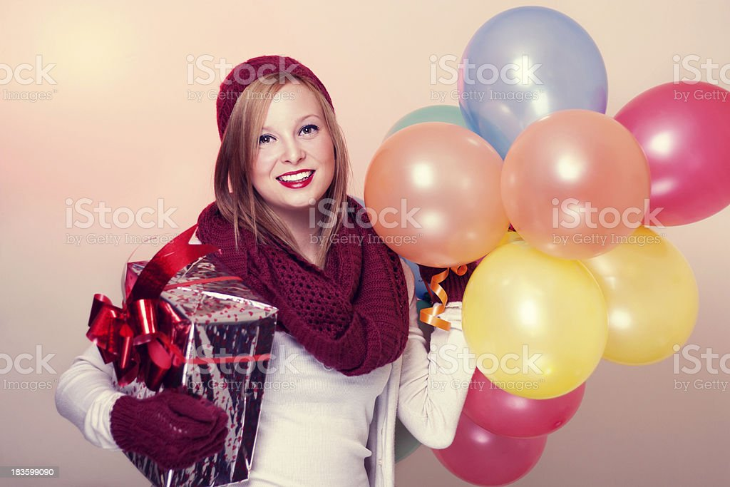 Young woman with balloons and gift. stock photo