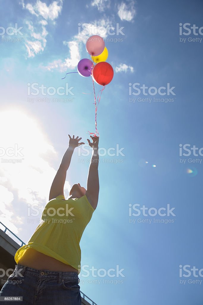 Young woman with balloons stock photo