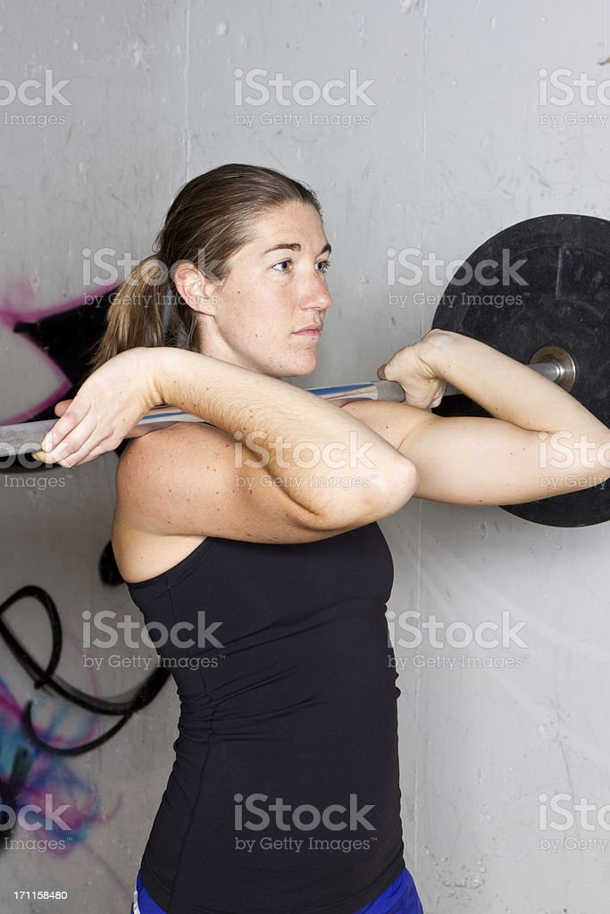 Young Woman with Barbell royalty-free stock photo