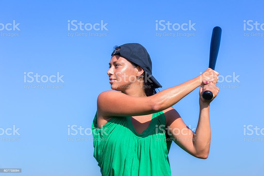 Young woman with baseball bat and cap stock photo