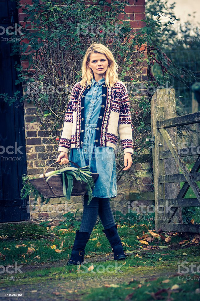 Young woman with basket and fresh garden produce - I stock photo