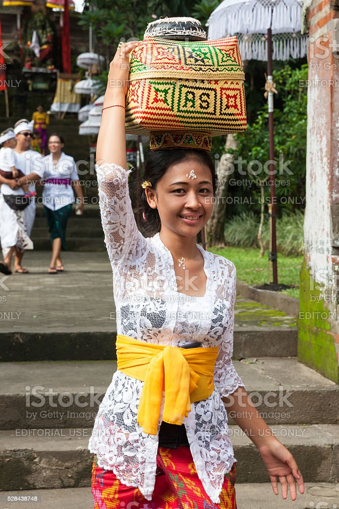 Young woman with basket on the head stock photo