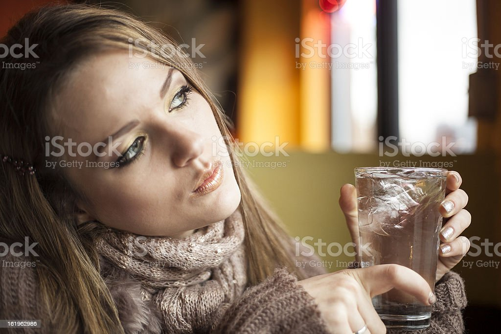 Young Woman with Beautiful Blue Eyes Drinking Water royalty-free stock photo