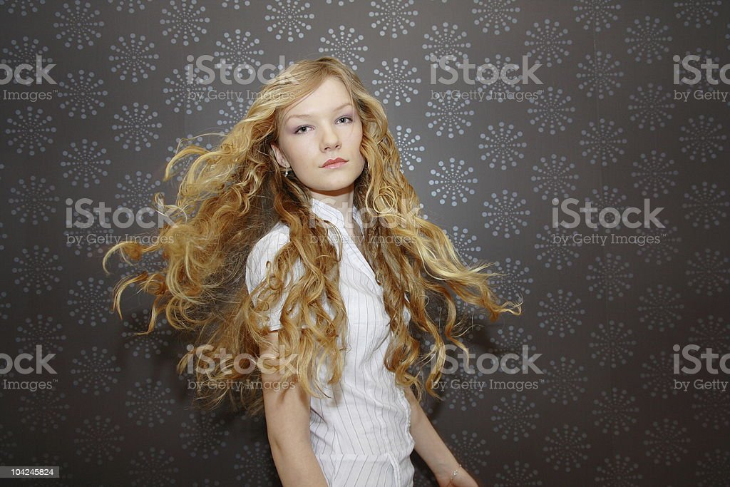 Young woman with beautiful moving hair royalty-free stock photo