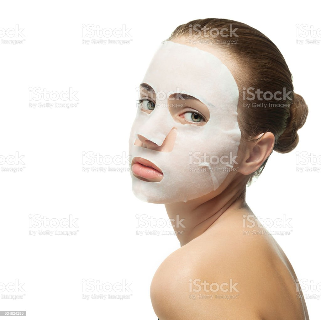 Young woman with beauty mask on her face. stock photo
