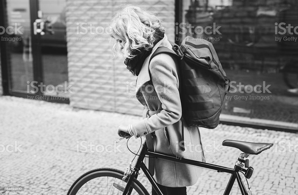 Young Woman With Bicycle In The City stock photo