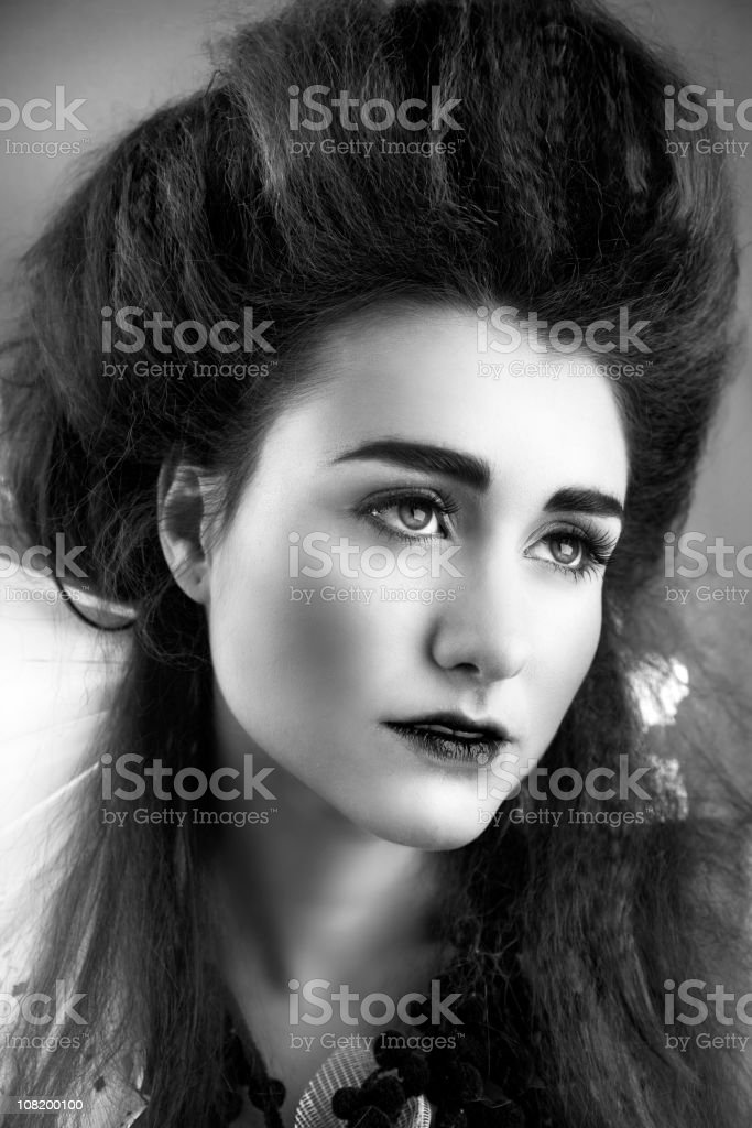 Young Woman With Big Hair Posing, Black and White stock photo
