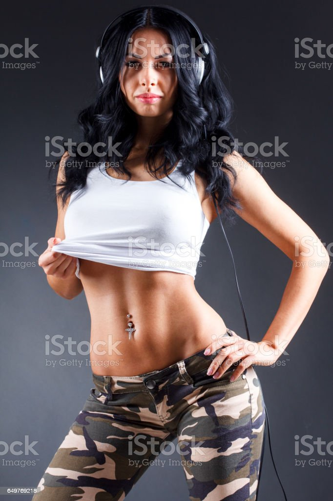 Young Woman with Big Headphones in Army Camouflage stock photo