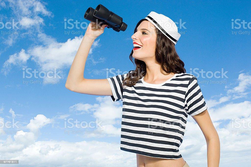 Young woman with binoculars stock photo