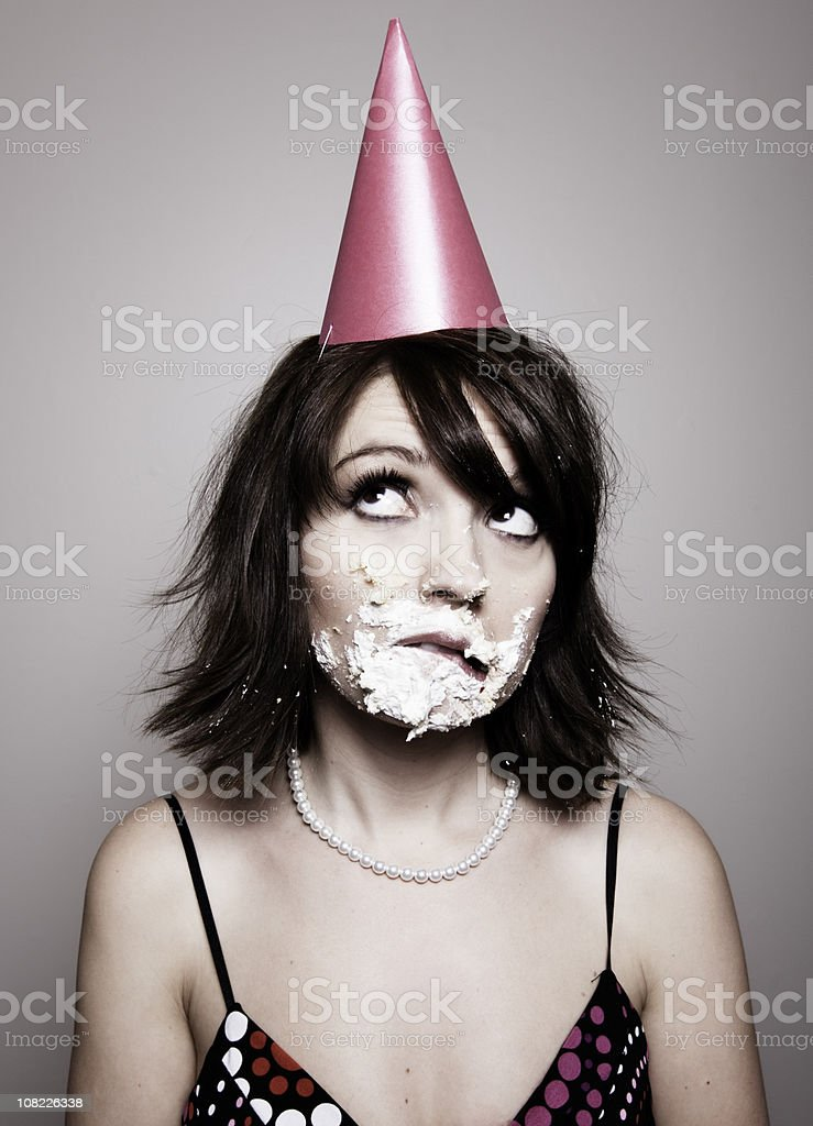 Young Woman With Birthday Cake on Face royalty-free stock photo