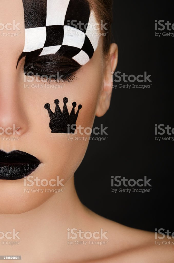 young woman with black and white face art stock photo