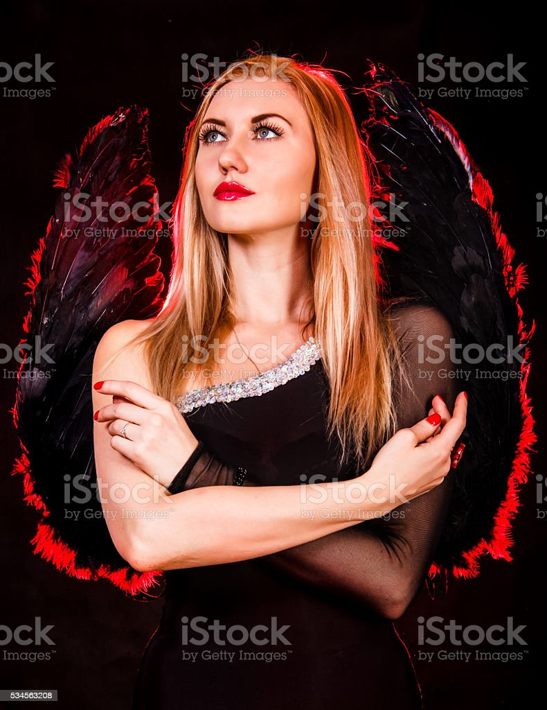 Young woman with black angel wings stock photo