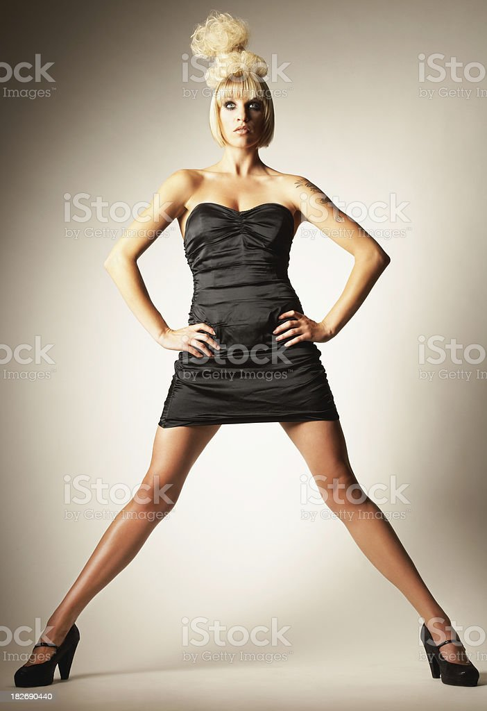 Young Woman With Black Dress and Wild Hair Style stock photo