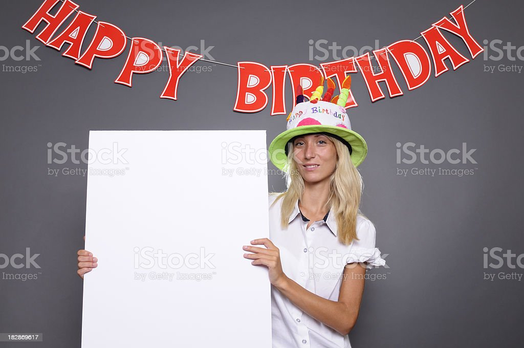 Young Woman with Blank Billboard under Happy Birthday Sign.Copy Space royalty-free stock photo
