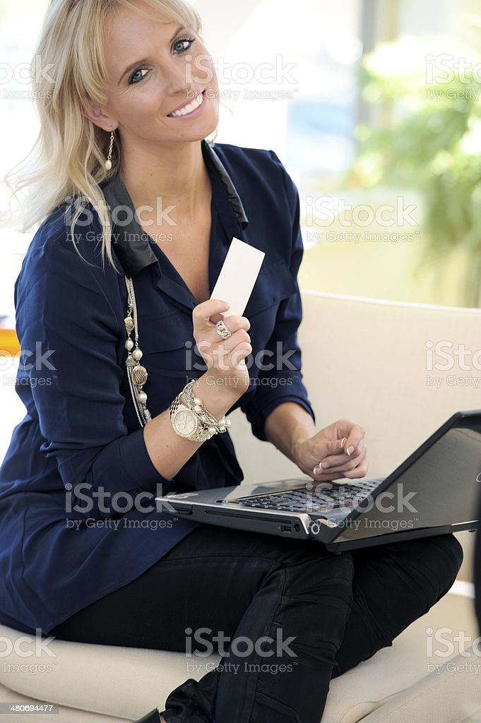 Young Woman with Blank Card and laptop. royalty-free stock photo