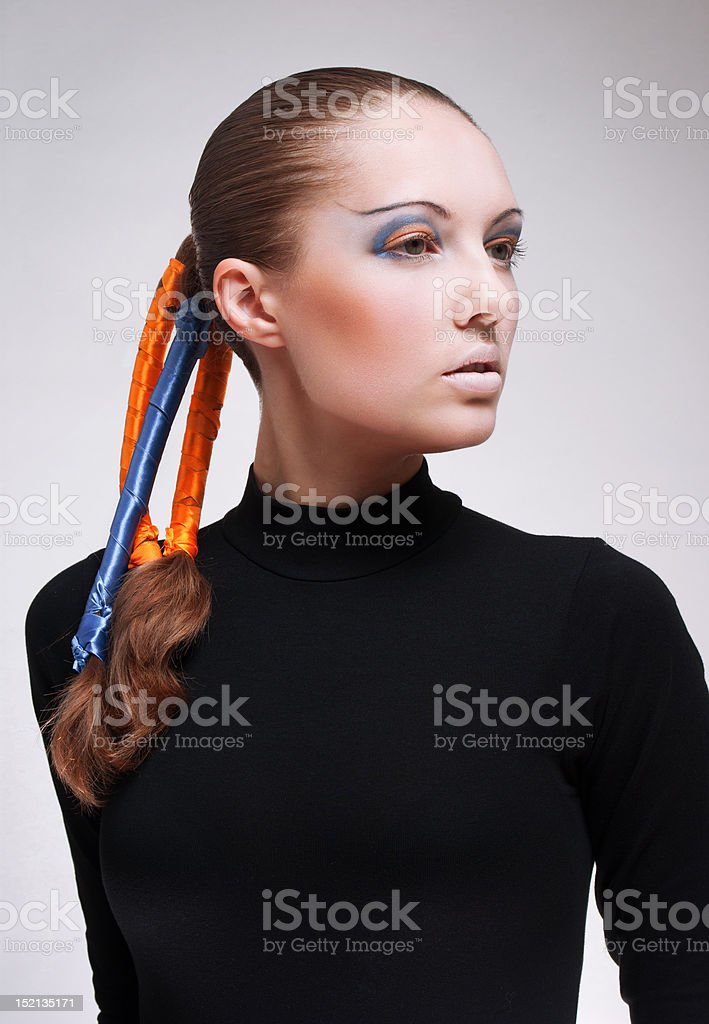 Young woman with blue and orange ribbons in hair royalty-free stock photo