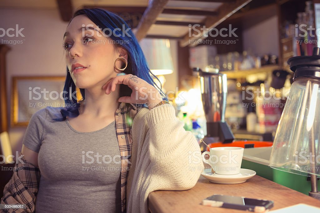 young woman with blue hair to the bar stock photo