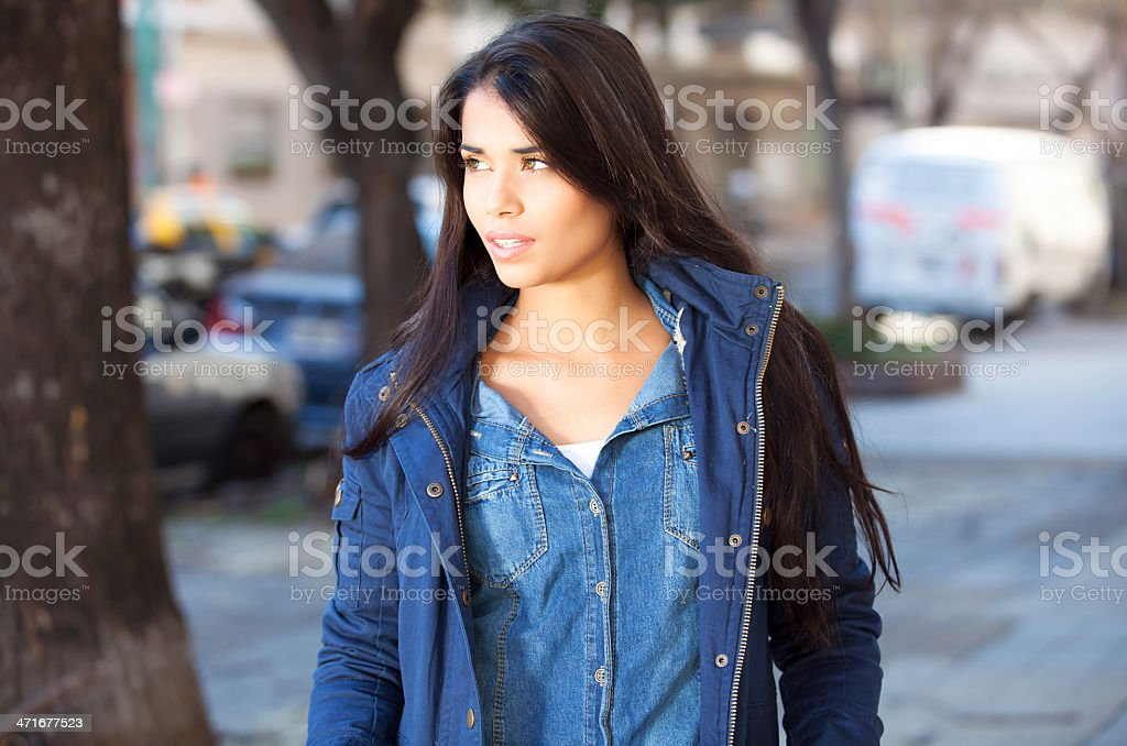 Young woman with blue jeans royalty-free stock photo